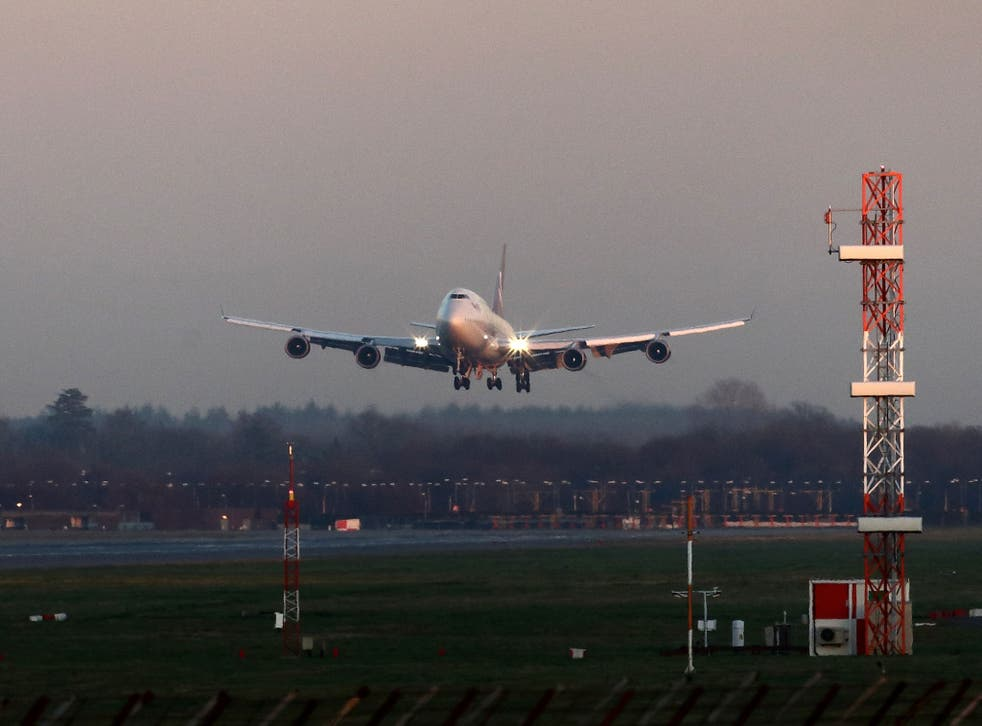 File: A plane comes in to land at Gatwick Airport