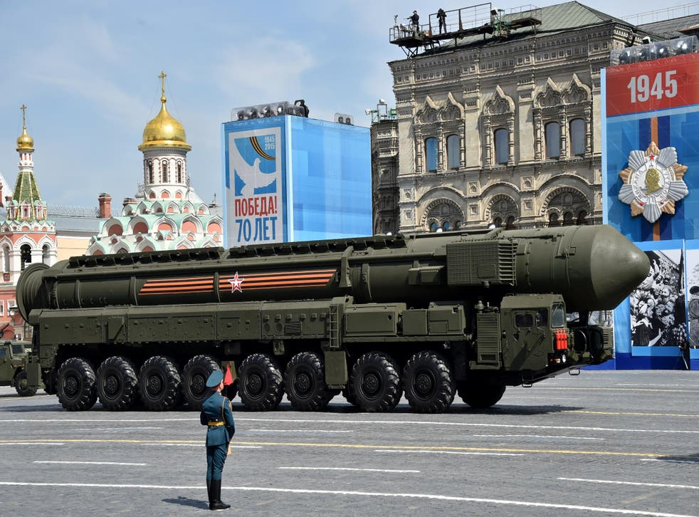 A Russian Yars RS-24 intercontinental ballistic missile system drives through Red Square in Moscow during the Victory Day military parade in May 2015