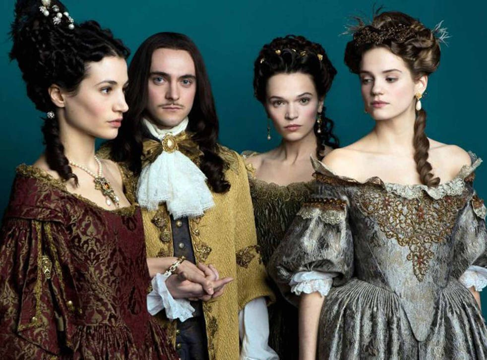 Court in the act: George Blagden, as Louis XIV, with three of his leading ladies