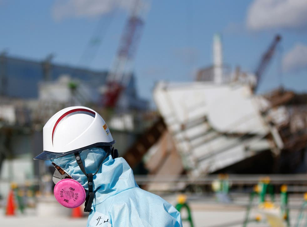 A Tokyo Electric Power Co. (TEPCO) employee tours the Fukushima nuclear power plant. Japan is preparing to mark the fifth anniversary of the disaster