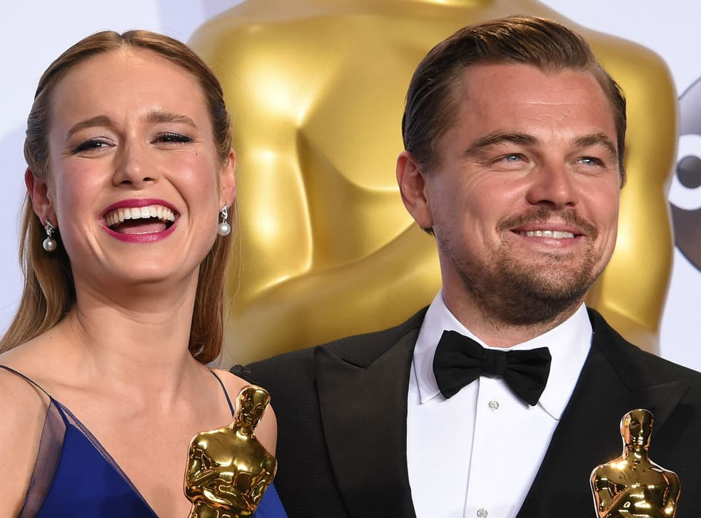 Brie Larson and Leonardo DiCaprio pose with their Oscars in the press room