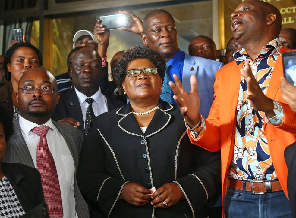 Zimbabwe's former Vice-President Joice Mujuru with supporters at a press conference in Harare