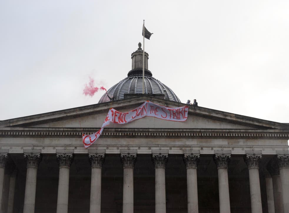 UCL Cut the Rent activists drop a banner from the roof of the Wilkins Portico, UCL's main building