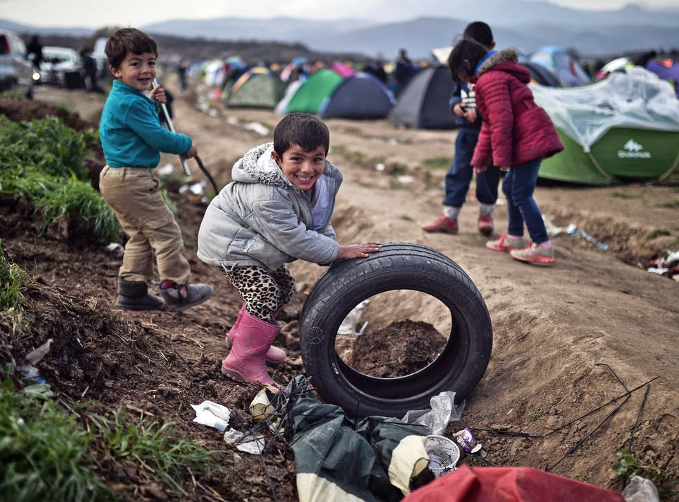Refugee children play in a makeshift camp at the Greek-Macedonian border