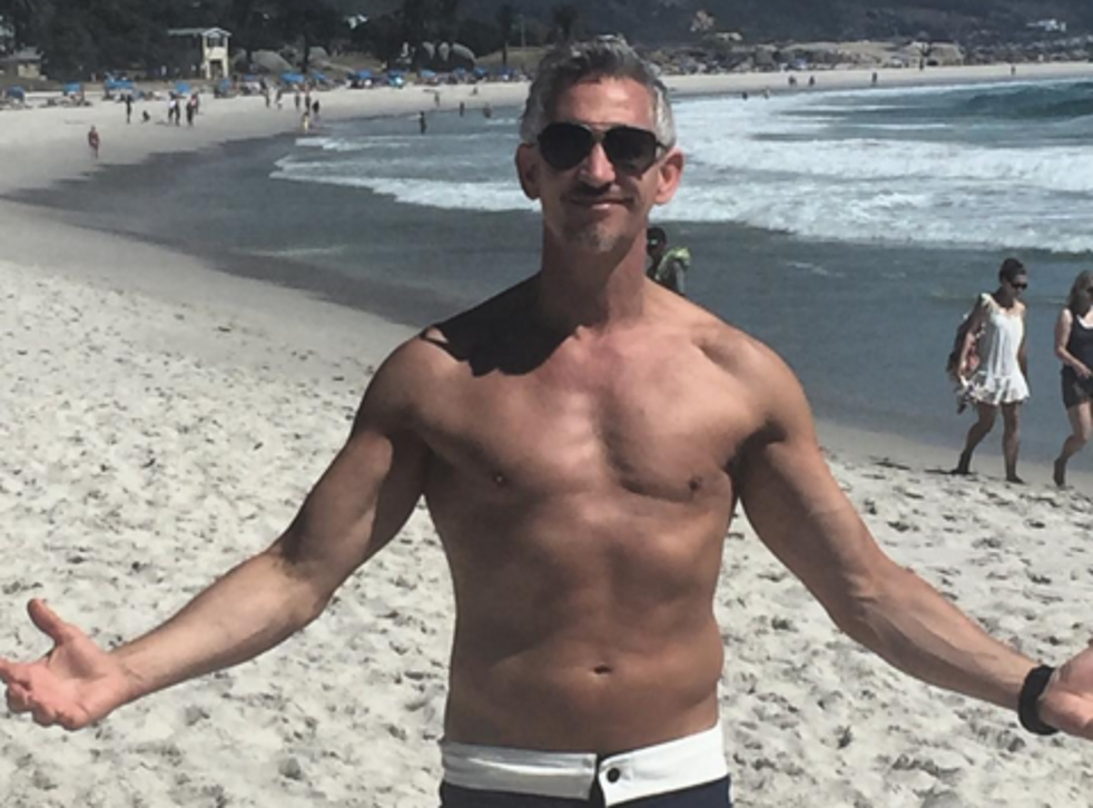 Gary Lineker poses on a Cape Town beach during a holiday to South Africa