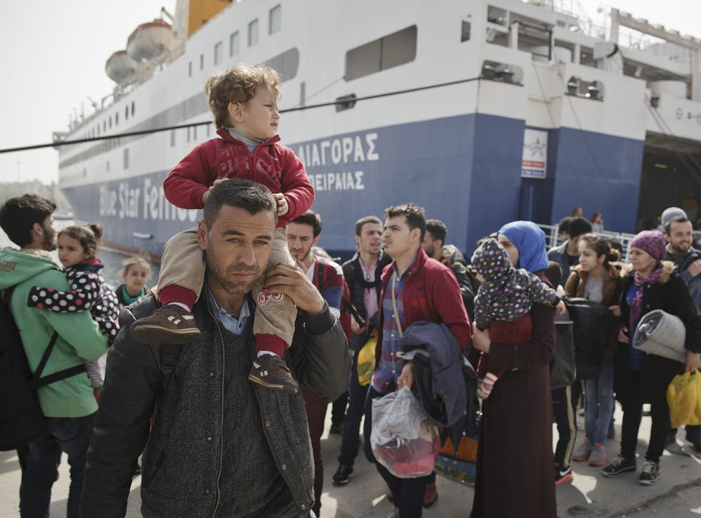 Refugees and migrants disembark from a ferry coming from Lesvos island, in the port of Piraeus, Greece, 01 March 2016.