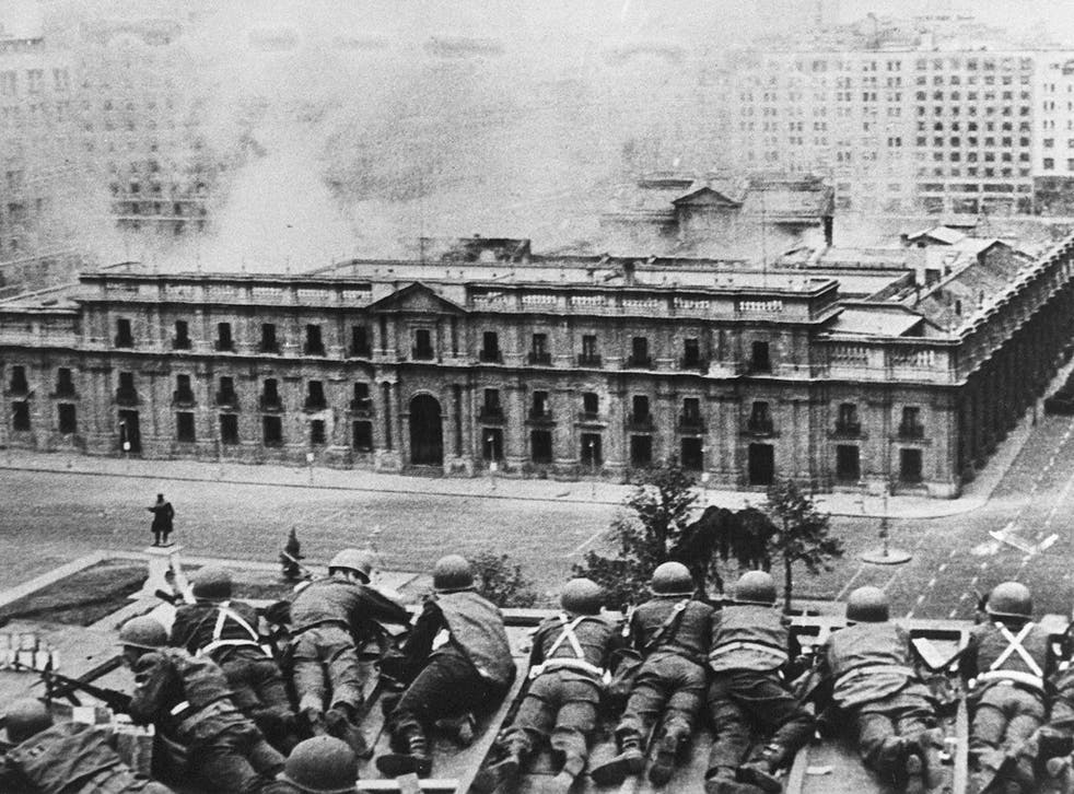 Chilean Army troops fire on La Moneda Palace, Santiago, during the 1973 coup led by General Augusto Pinochet. President Salvador Allende died in the attack