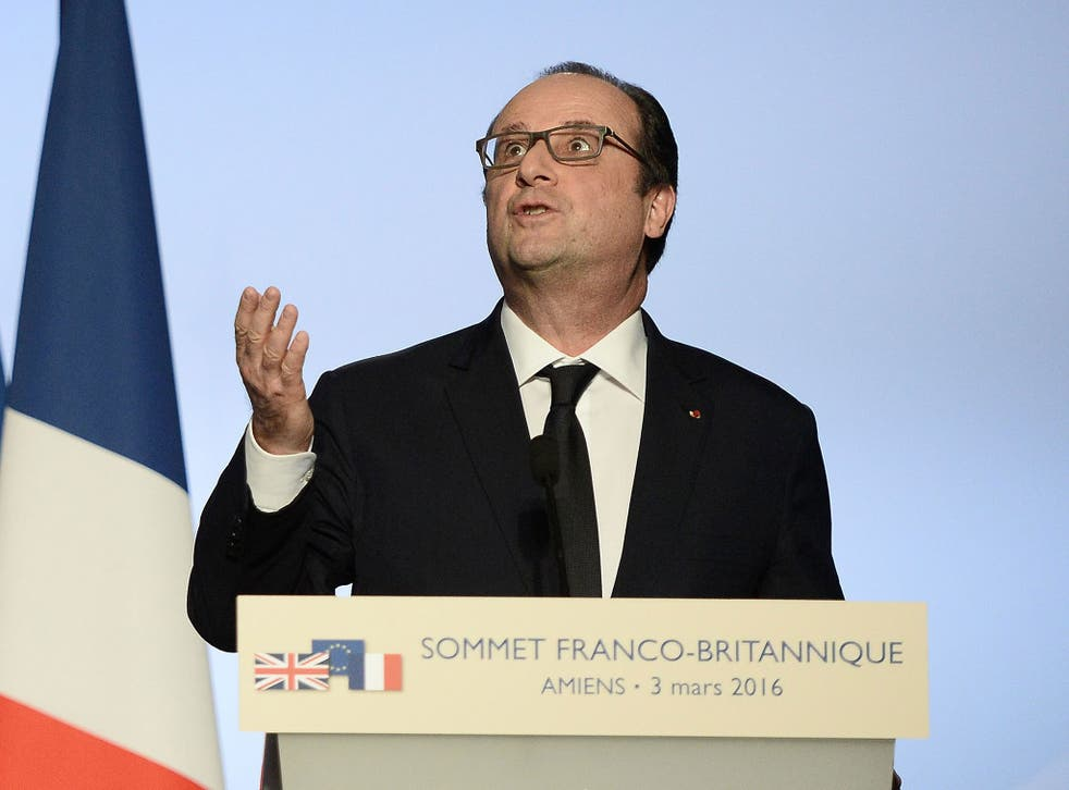 French President Francois Hollande gives a press conference at the Musee de Picardie in Amiens, northern France, during the 34th Franco-British summit