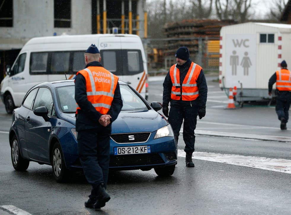 Belgian police officers check cars at the border between France and Belgium