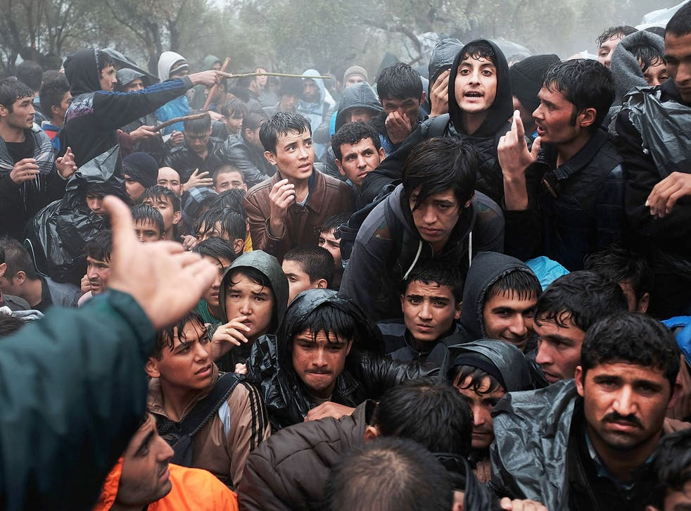 Asylum seekers from Afghanistan wait to be processed