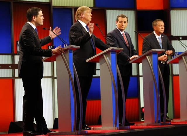 Republican presidential candidates, Sen. Marco Rubio, R-Fla., and businessman Donald Trump argue as Sen. Ted Cruz, R-Texas, and Ohio Gov. John Kasich listen during a Republican presidential primary debate