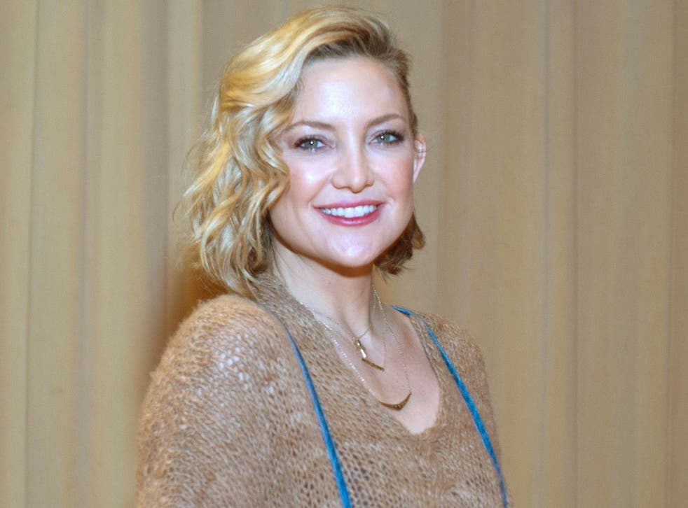Golden smile: Kate Hudson, who has a new book about how to be happy Cindy Barrymore/REX