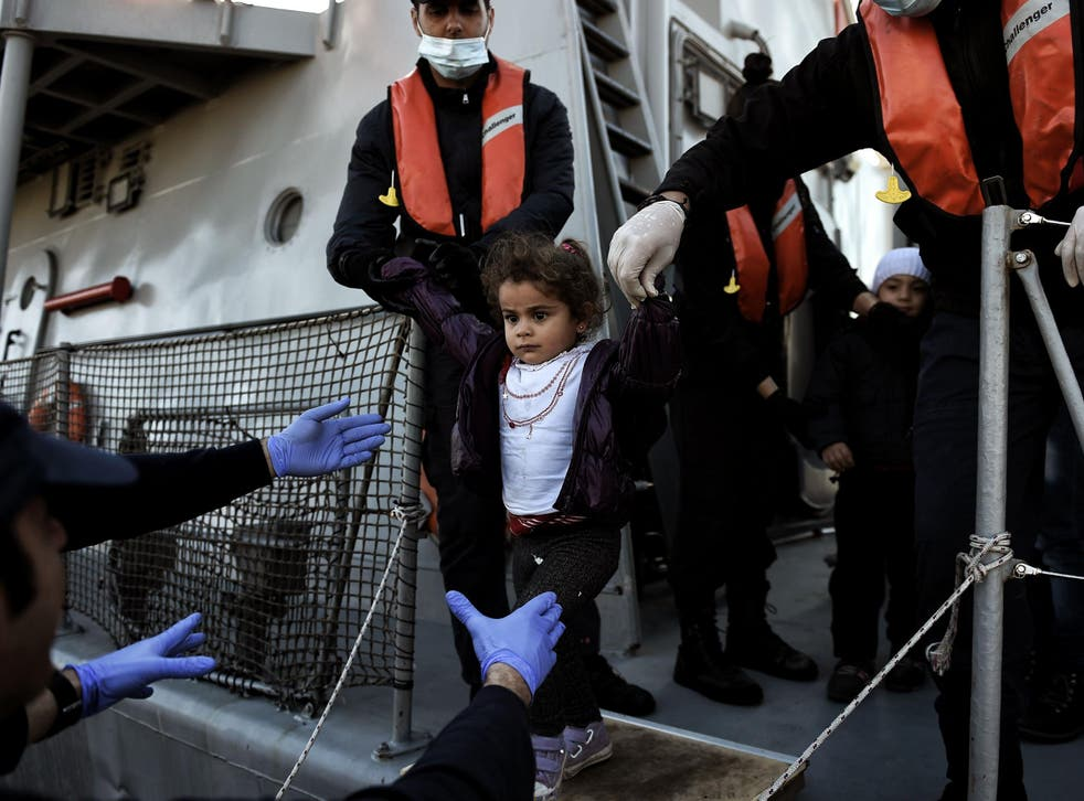 A migrant girl looks on upon arrival at the northern island of Lesbos after crossing the Aegean sea with other migrants and refugees from Turkey.