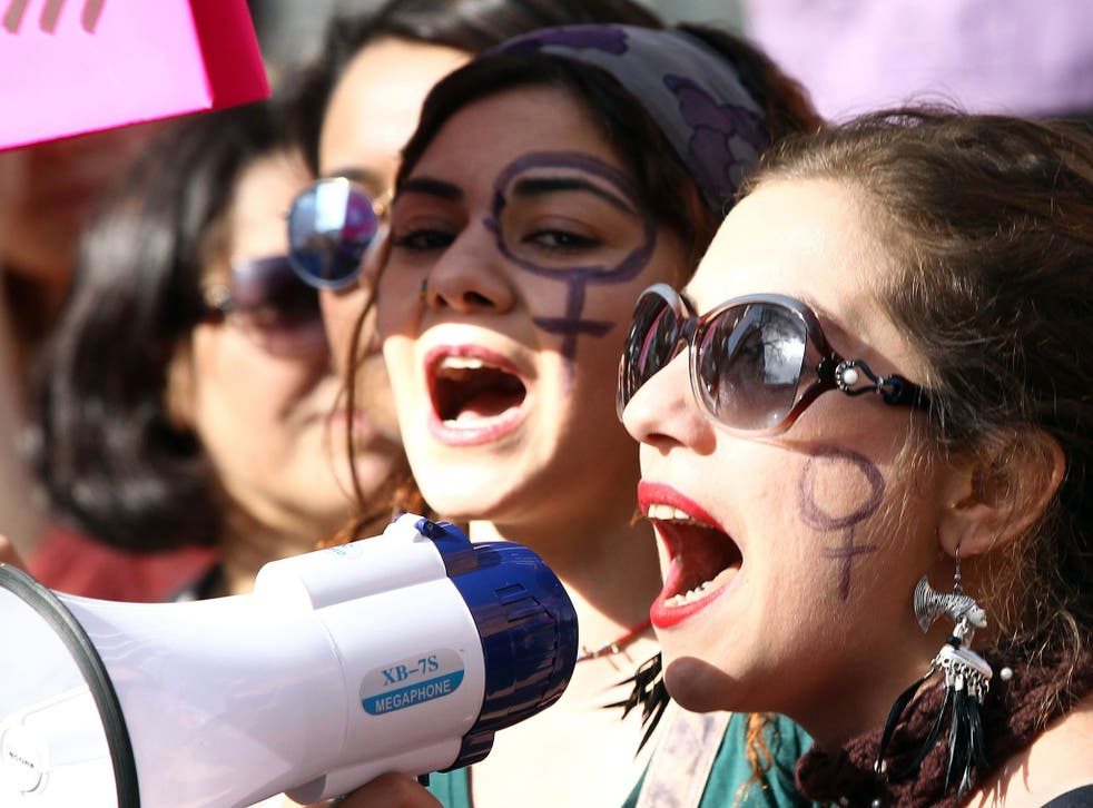 Turkish women shout slogans during a rally to mark International Women's Day in Ankara, on March 8, 2015.