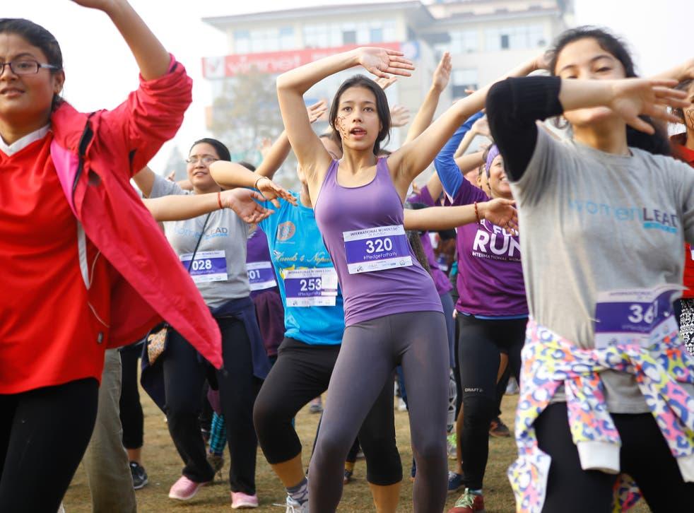 Nepalese women enjoy some Zumba dance after completing a fun-run to celebrate International Women's Day near Kathmandu