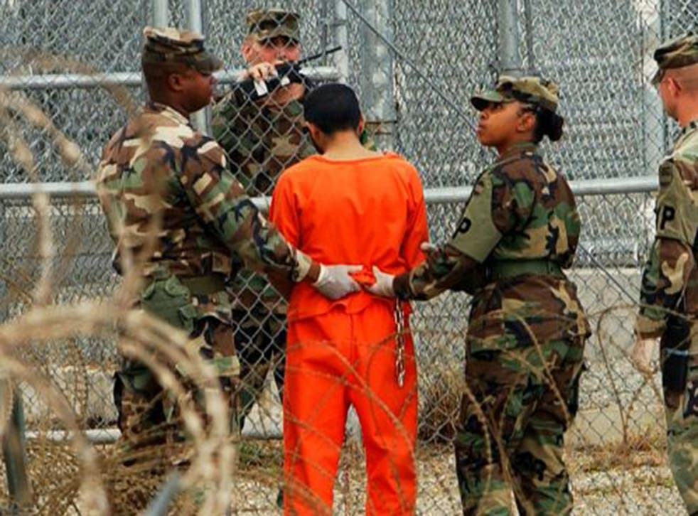 A prisoner is taken for questioning at Guantanamo