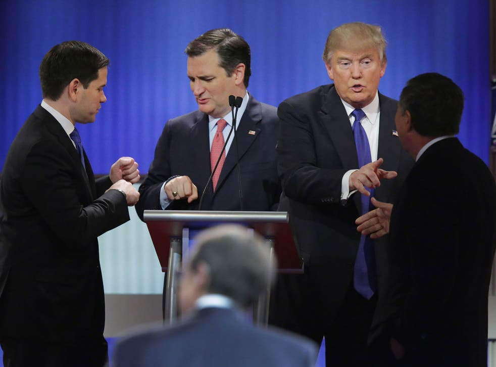 Republican presidential candidates greet each other following a debate sponsored by Fox News at the Fox theatre on March 3, 2016 in Detroit, Michigan