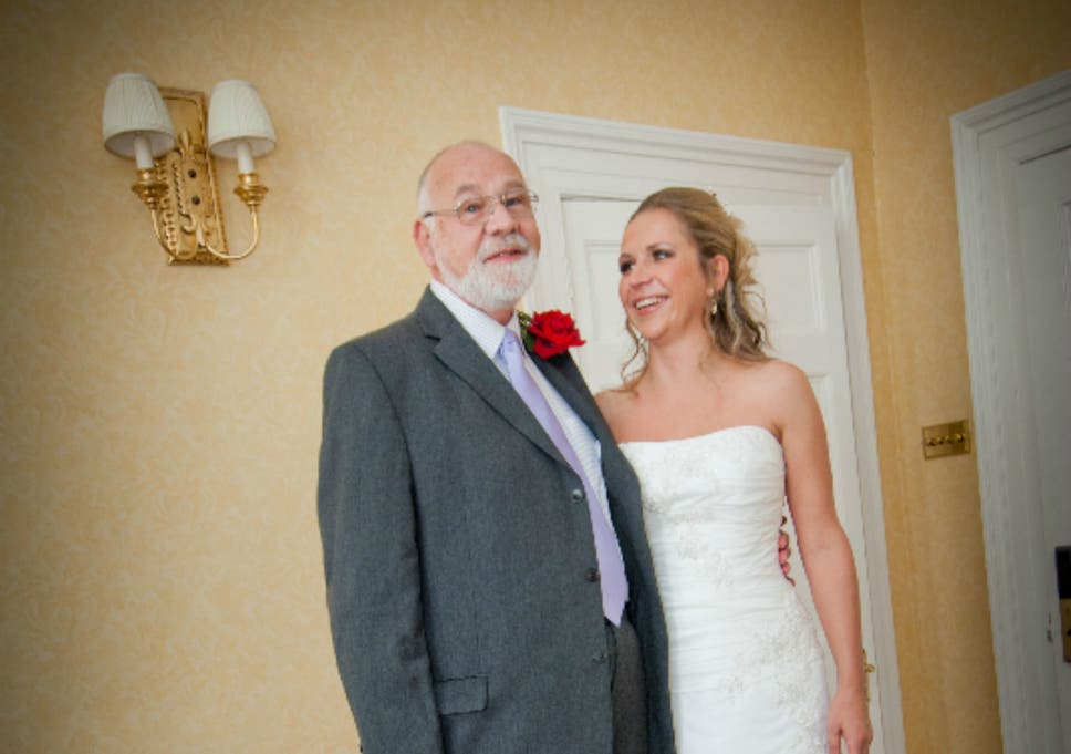 b34c1184 Emily and her father Kevin pose for a photo on her wedding day in 2011