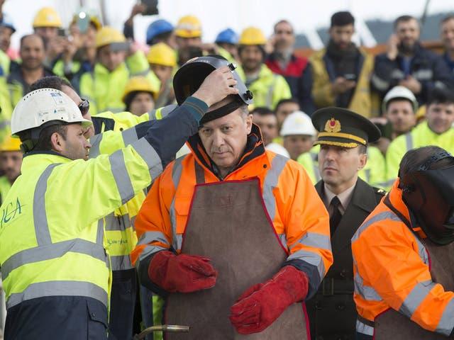 Turkey's President Tayyip Erdogan prepares for the welding of the final section of the Yavuz Sultan Selim Bridge, the Third Bosphorus Bridge, during a ceremony in Istanbul, Turkey