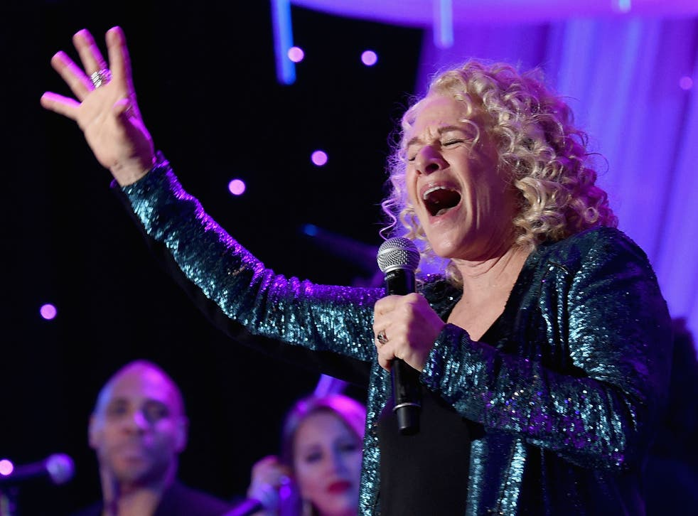 Carole King performing at a pre-Grammy gala in 2015