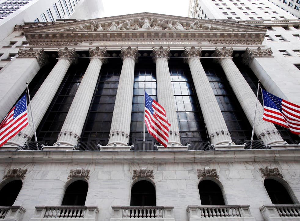American flags fly in front of the New York Stock Exchange