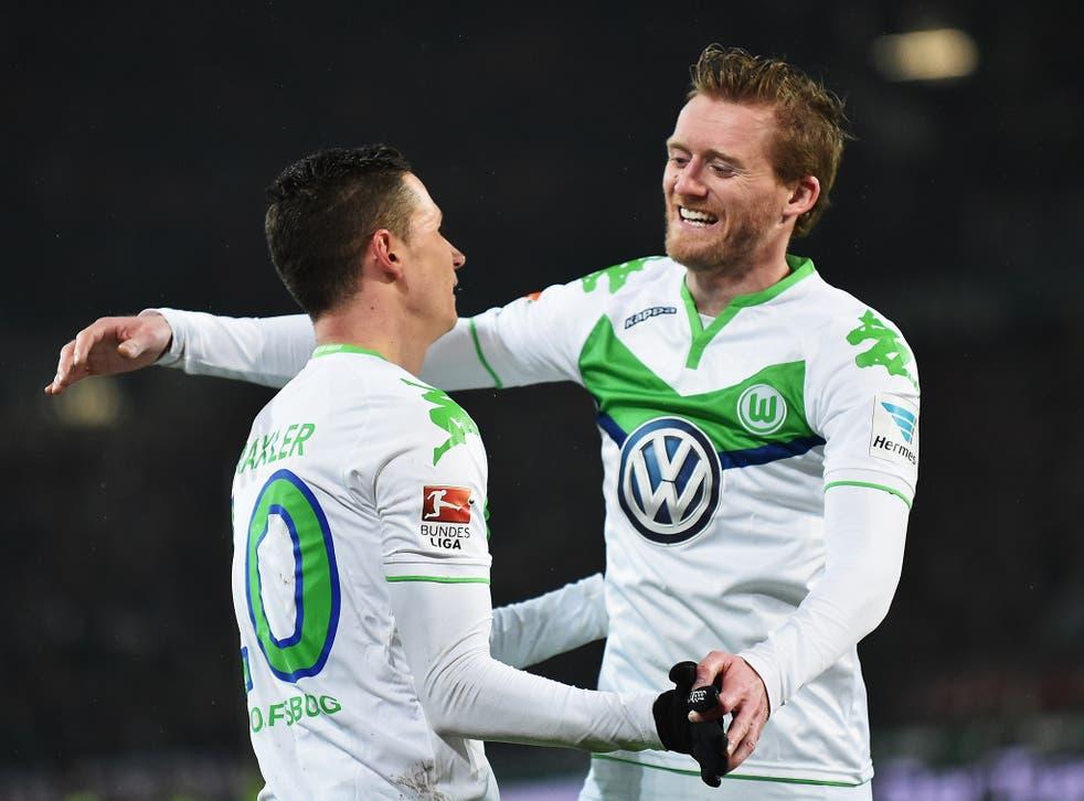 Wolfsburg forward Andre Schurrle celebrates with team-mate Julian Draxler