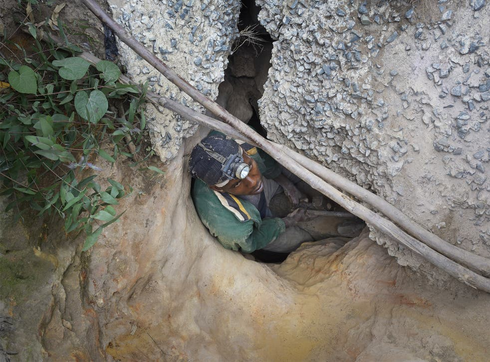 Andile Jeremiah enters an abandoned mine in South Africa