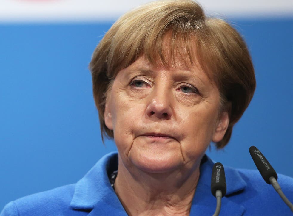 German Chancellor Angela Merkel speaks to supporters at a campaign rally in Nuertingen