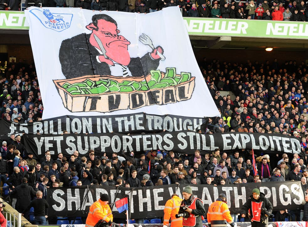 Crystal Palace supporters display banners in protest against high ticket prices