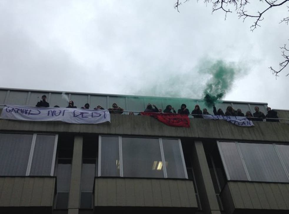 Occupiers, pictured, on the balcony of Bramber House and flying banners while chanting: 'Don't Deport Luqman'