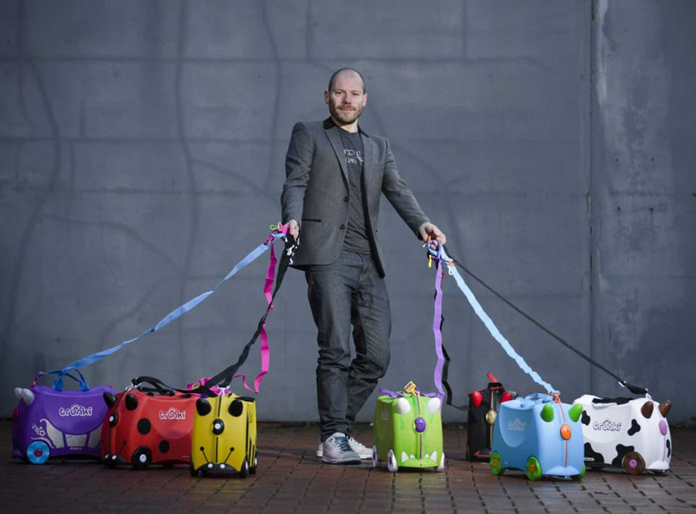 <p>Trunki founder Rob Law with his creations</p>