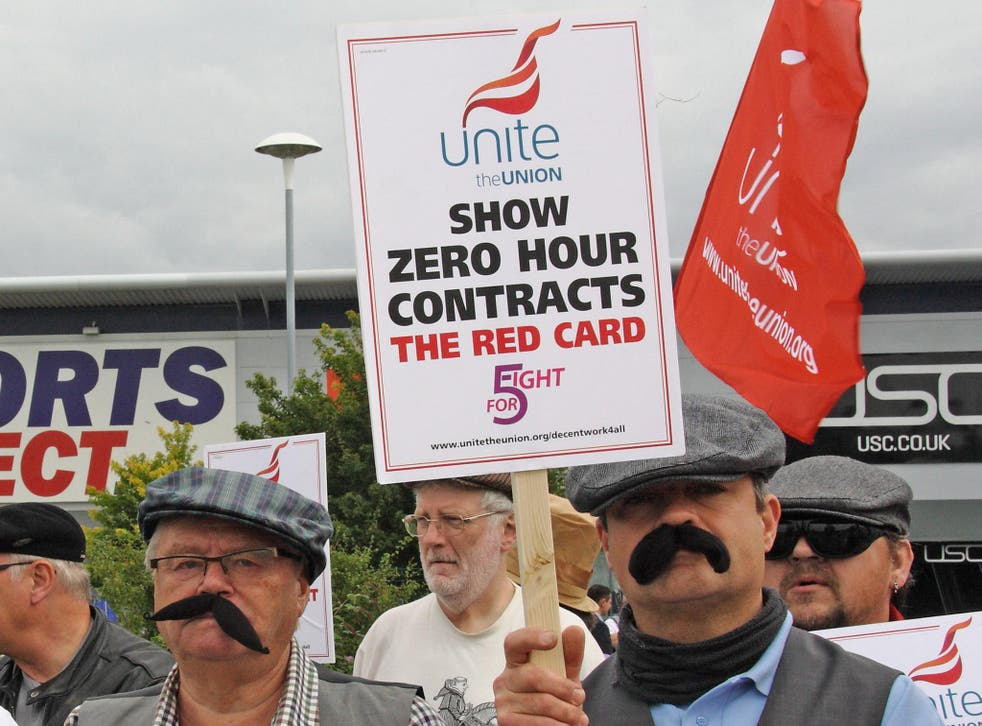 Unite union members dressed as Dickensian workers protesting against zero-hours contracts outside the headquarters of Sports Direct