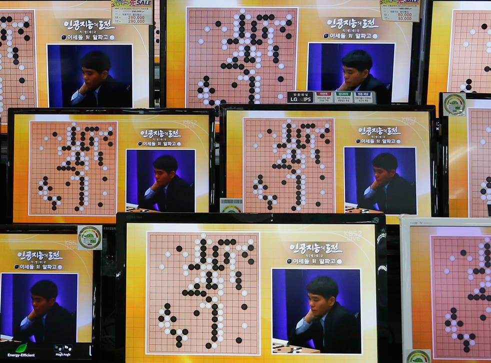 South Korean professional Go player Lee Sedol is seen on TV screens during the Google DeepMind Challenge Match against Google's artificial intelligence program, AlphaGo, at the Yongsan Electronic store in Seoul, South Korea