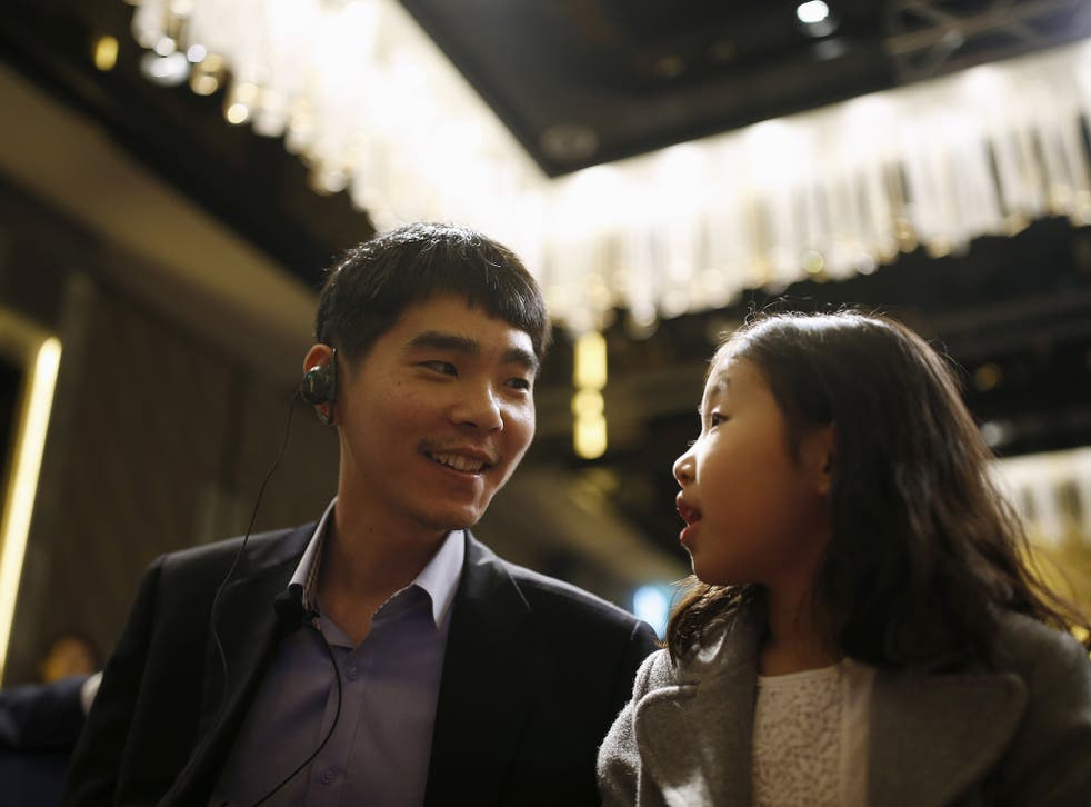South Korea's Lee Sedol, the world's top Go player, talks with his daughter during a news conference ahead of matches against Google's artificial intelligence program AlphaGo, in Seoul, South Korea, March 8, 2016