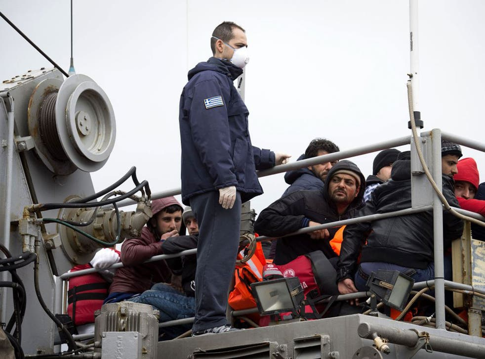 Refugees on the deck of a Greek coast guard boat