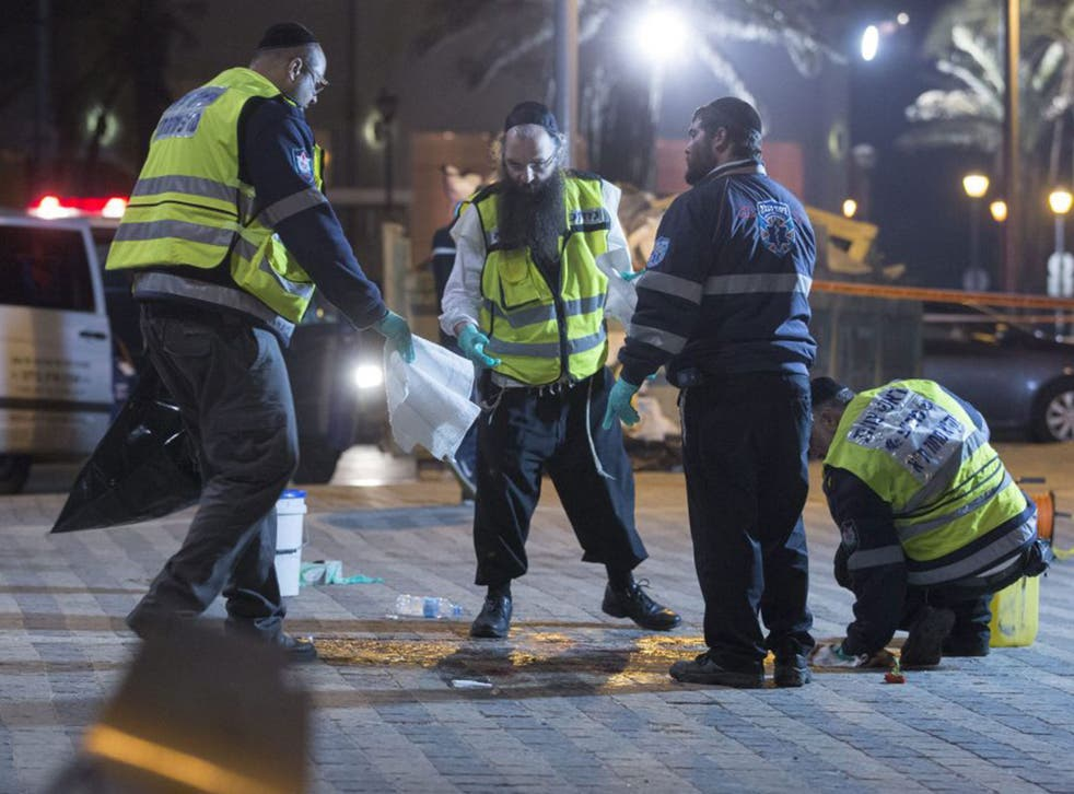 The clean-up operation gets underway at the scene of the stabbing attack in old Jaffa, just south of Tel Aviv, Israel