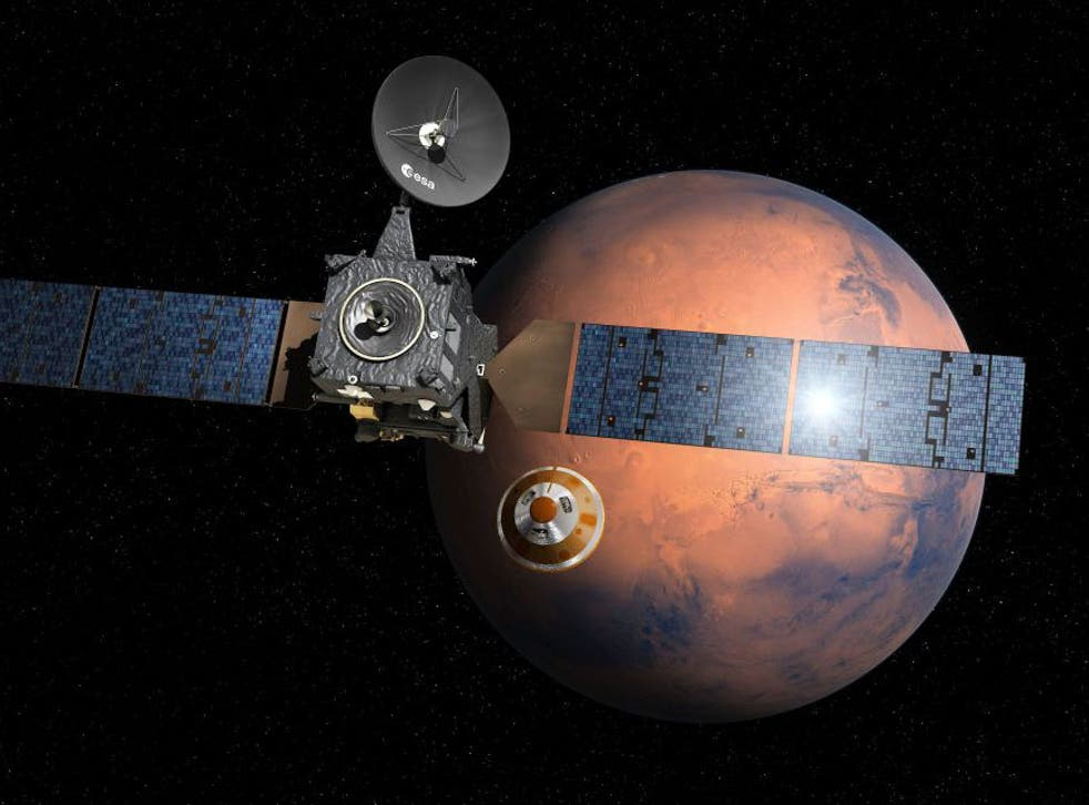 An artist's impression of the ExoMars Schiaparelli module separating from the orbiter