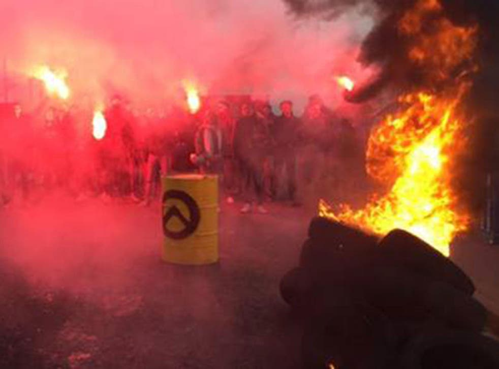 Generation Identitaire activists burned tyres and set off flares before the demonstration was dismantled by police on 12 March