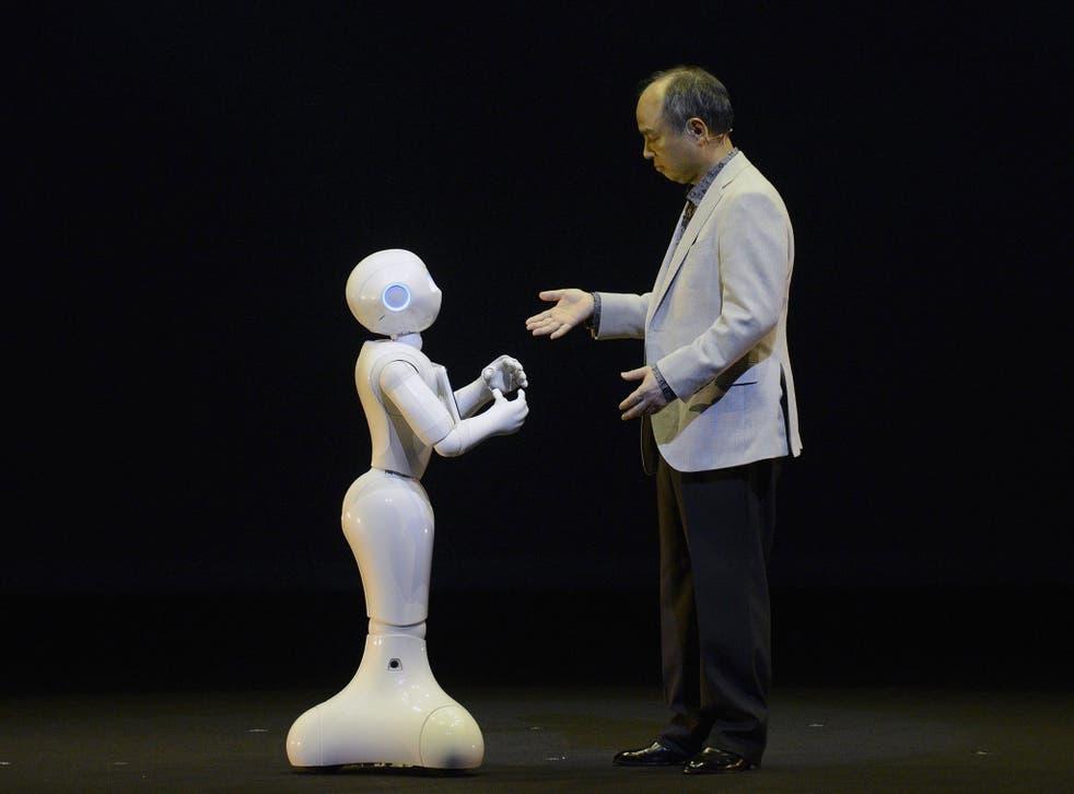 Electric dreams: SoftBank CEO Masayoshi Son interacts with humanoid robot 'Pepper'  EPA