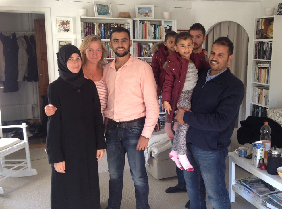 Lisbeth Zornig with the family of Syrian refugees she drove from Rodby to Copenhagen on 7 September 2015