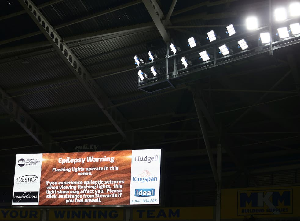 The jumbo screen at Arsenal's Emirates stadium gives an epilepsy warning ahead of a recent FA Cup match. The Epilepsy Society says almost four in 10 epilepsy-related deaths are avoidable