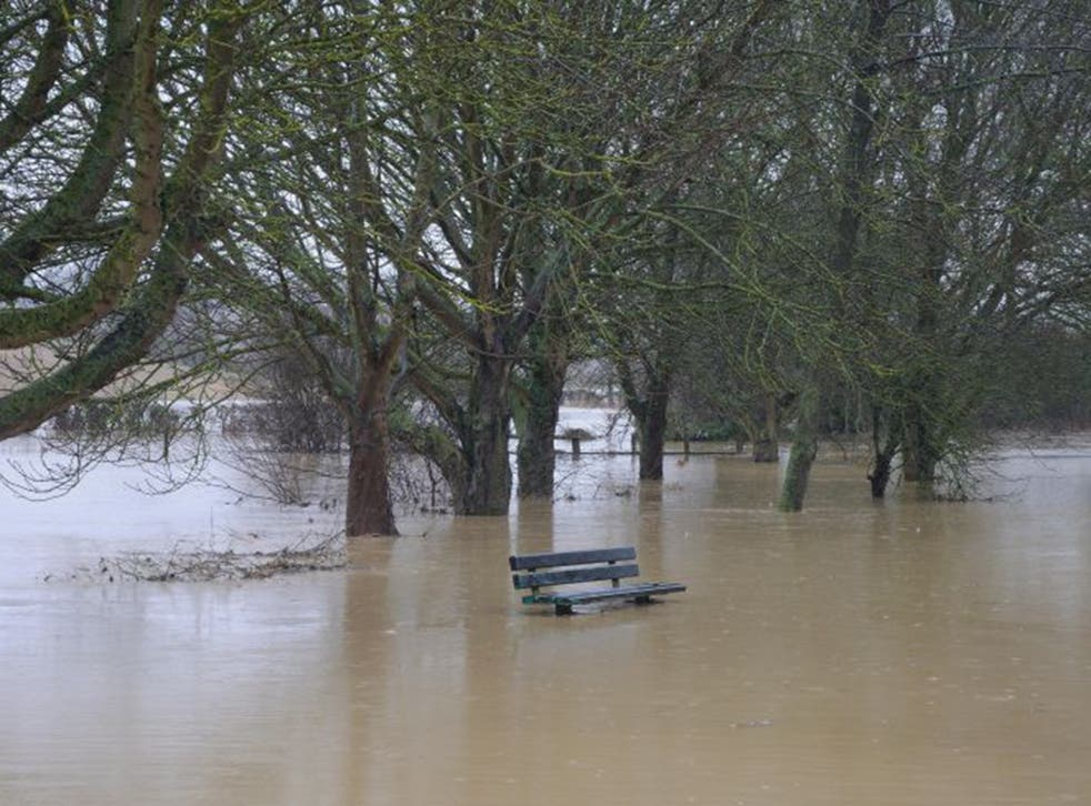 Evidence floods in: The river Glen burst its banks, submerging roads in Corby Glen, Lincs