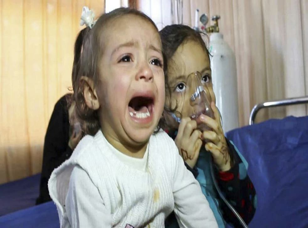 Young victims exposed to a chemical attack wait for treatment at a hospital in Taza