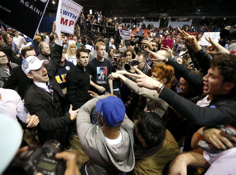 Supporters of Republican presidential candidate Donald Trump, left, face off with protesters in Chicago.