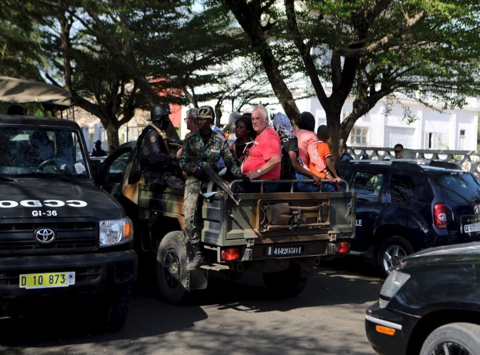 Security forces evacuate people in Bassam, Ivory Coast