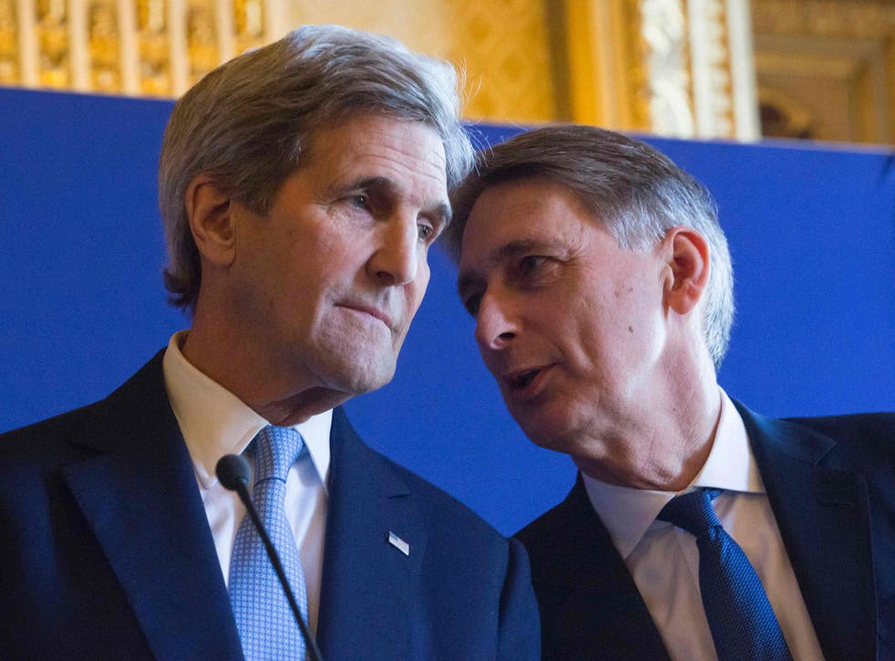 John Kerry, left, with British Foreign Secretary Philip Hammond