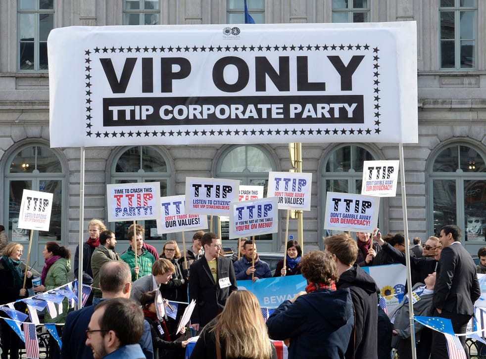Protesters demonstrate in Brussels against the TTIP