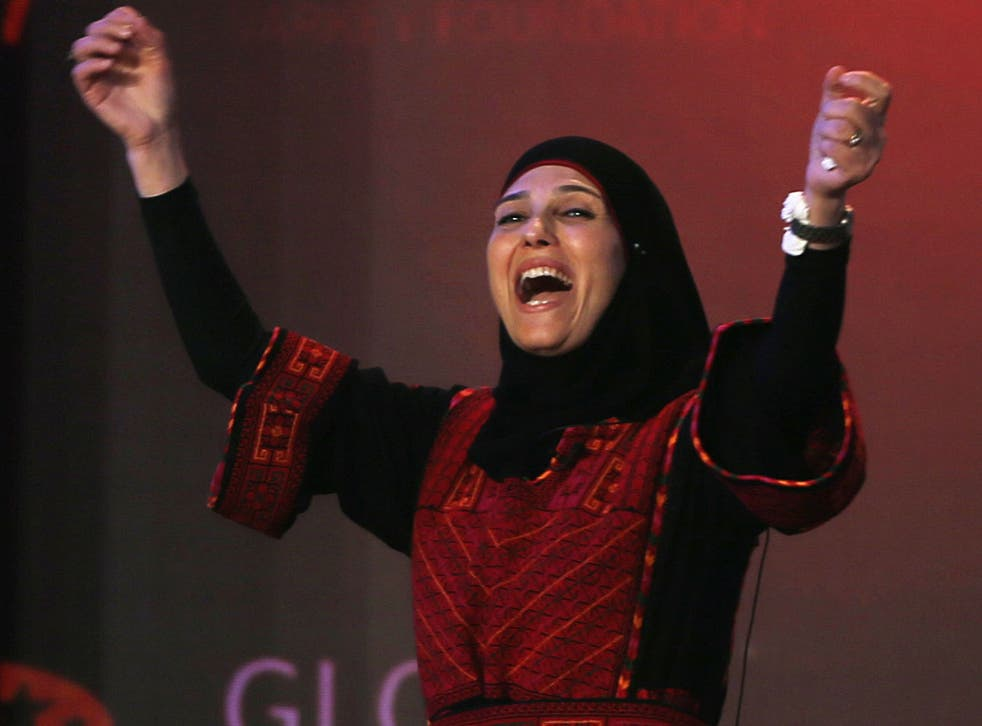 Palestinian primary school teacher Hanan al-Hroub reacts after she won the second annual Global Teacher Prize