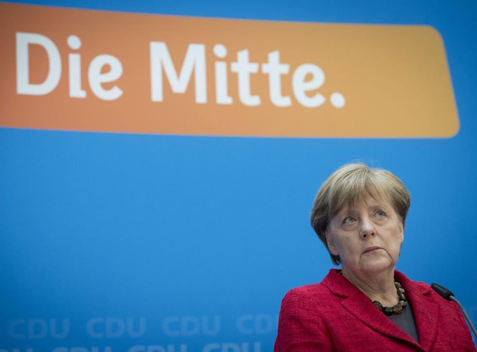 Angela Merkel looks shaken as she addresses the media in Berlin in the wake of her poll humiliation