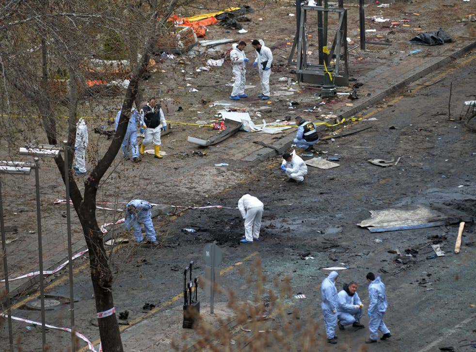 Police forensic officials work at the explosion site in Ankara